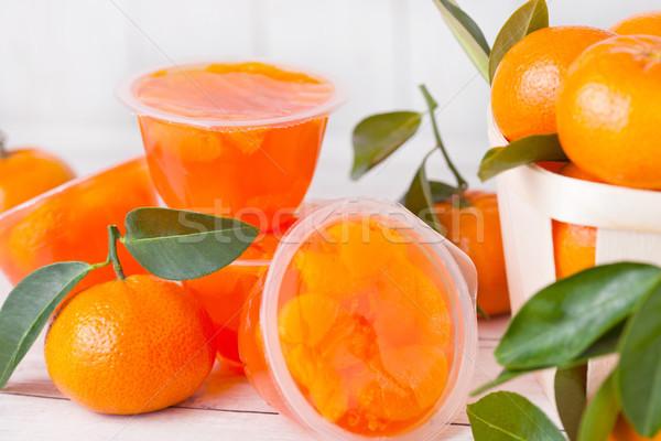 Plastic containers with mandarine tengerine jelly Stock photo © DenisMArt