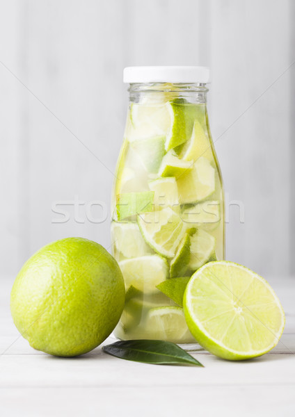 Glass bottle of lime still fruit water with fruits Stock photo © DenisMArt