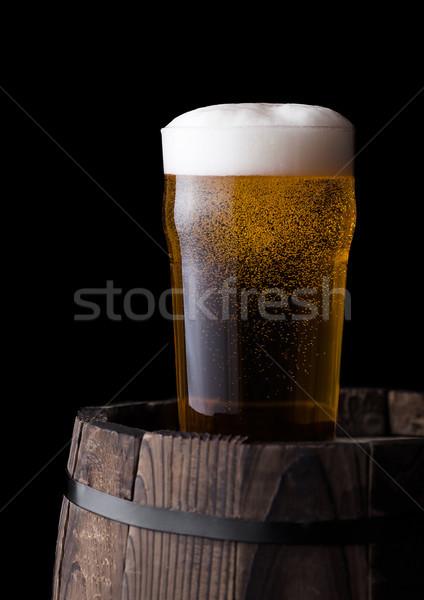 Froid verre bière vieux bois baril Photo stock © DenisMArt