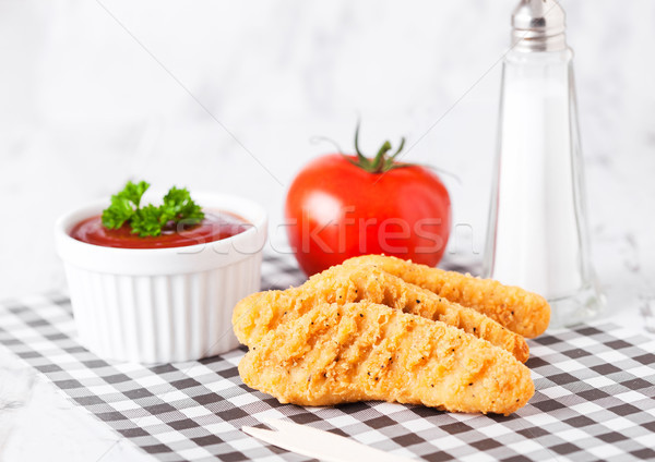 Fried chicken dippers on chopping board with sauce Stock photo © DenisMArt