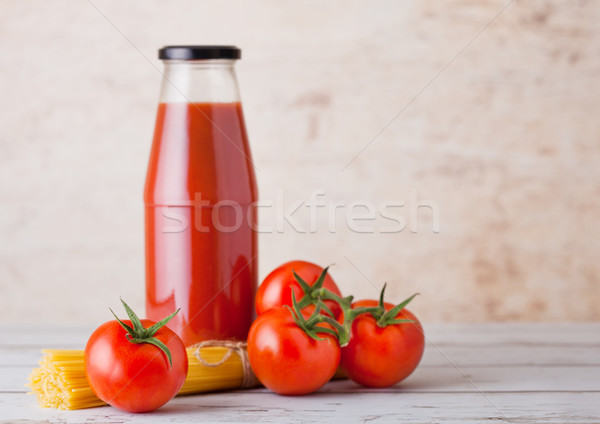 Glass bottle of tomato paste with raw spaghetti  Stock photo © DenisMArt