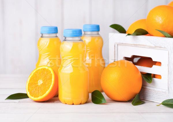 Műanyag üveg nyers organikus friss narancslé Stock fotó © DenisMArt