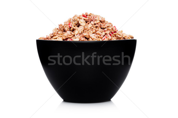 Black bowl with natural organic granola cereal Stock photo © DenisMArt