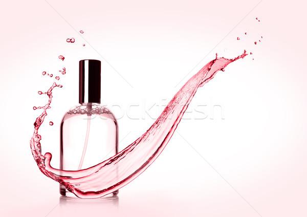 Lujo rosa líquido perfume botella salpicaduras Foto stock © DenisMArt