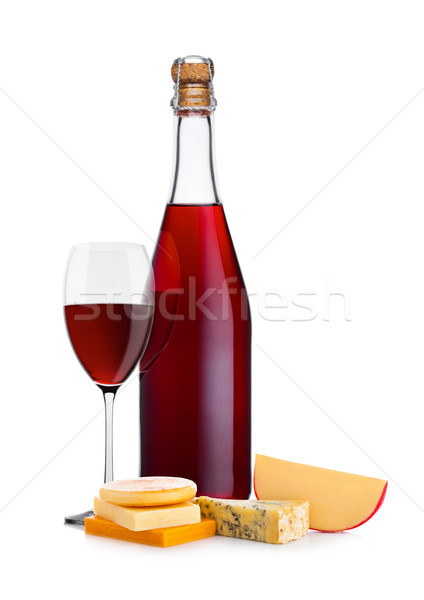 Bottle of homemade red wine with cheese selection Stock photo © DenisMArt