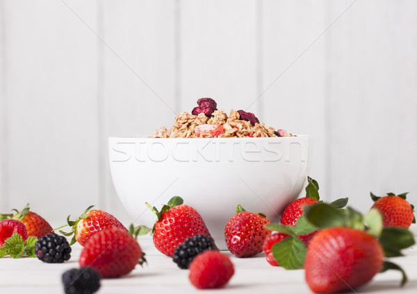 Bowl with breakfast cereal and fresh berries Stock photo © DenisMArt