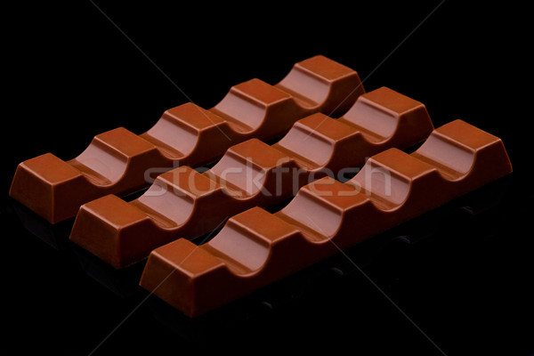 Tej csokoládé édes rácsok fekete bár Stock fotó © DenisMArt