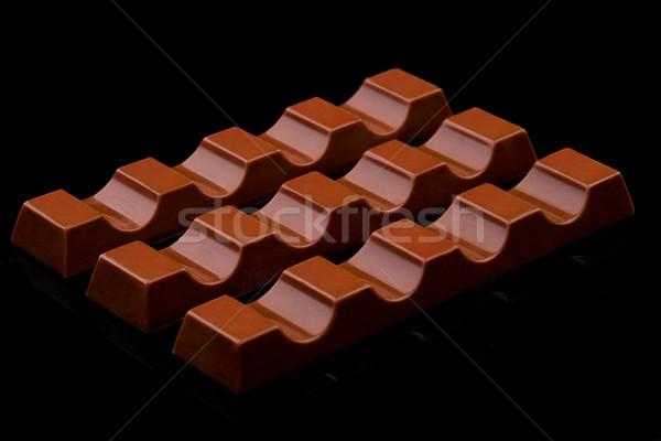 Milk chocolate sweet bars on black Stock photo © DenisMArt