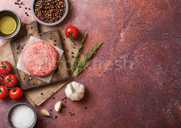Raw minced home made grill beef burger with spices and herbs. Top view with space for your text Stock photo © DenisMArt