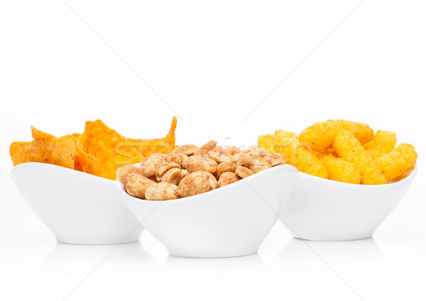 Stock photo: Cheese corn snacks and nachos with salty peanuts