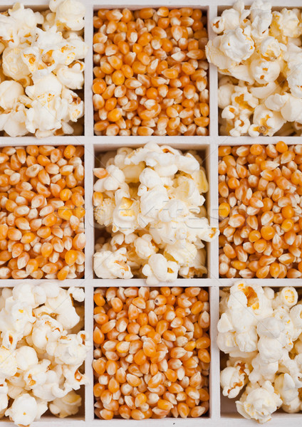 Nyers arany csemegekukorica magok pattogatott kukorica doboz Stock fotó © DenisMArt