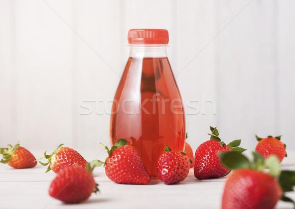пластиковых бутылку Ягоды соды сока пить Сток-фото © DenisMArt