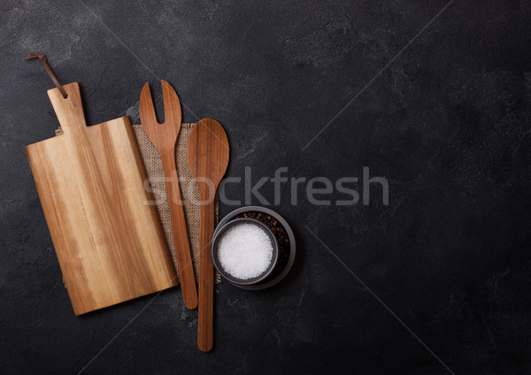 Vintage kitchen wooden utensils with chopping board on stone table background. Top view. Space for t Stock photo © DenisMArt