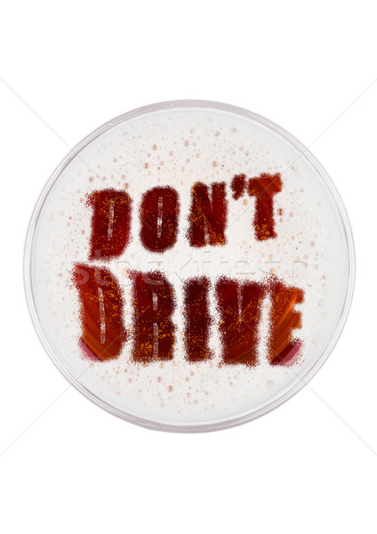 Glass of red ale beer top with don't drive shape Stock photo © DenisMArt