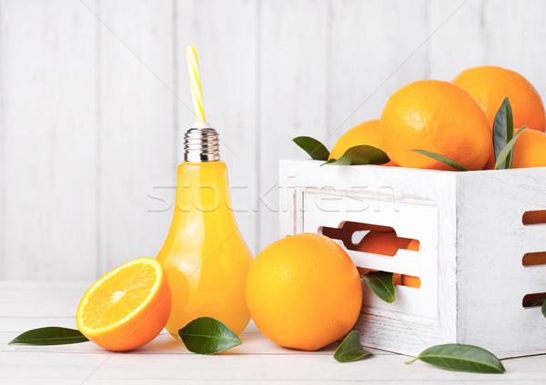 Glass lamp shape of organic fresh orange juice  Stock photo © DenisMArt