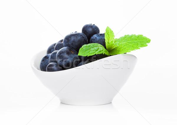 Fresh healthy organic blueberry in white bowl Stock photo © DenisMArt