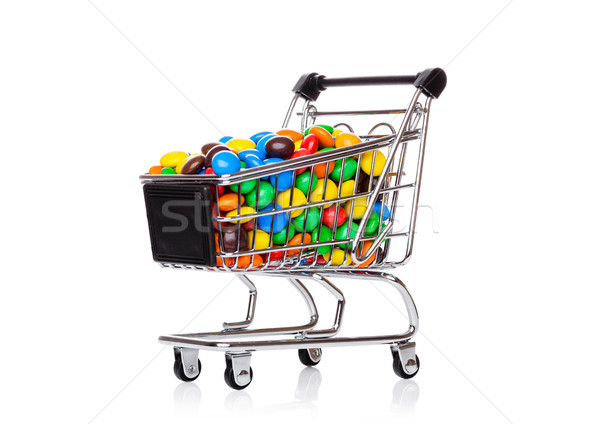 Round coated sweet candies in shopping cart Stock photo © DenisMArt