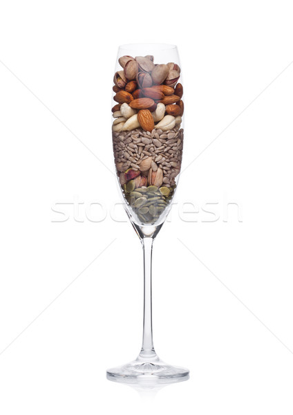 Glass with healthy organic nuts almonds and cashew Stock photo © DenisMArt