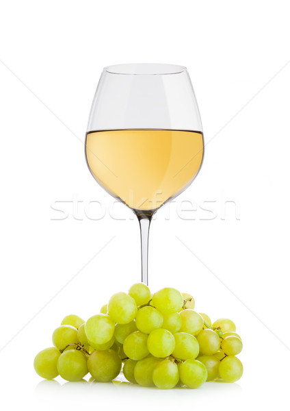 Glass of white wine with green grapes Stock photo © DenisMArt