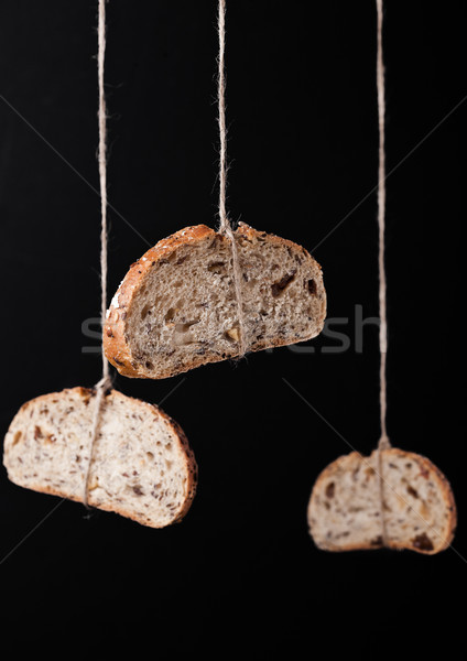 Freshly baked bread with oats hanging on rope Stock photo © DenisMArt
