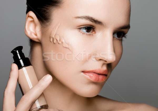 Beauty fashion model woman holding foundation tube Stock photo © DenisMArt