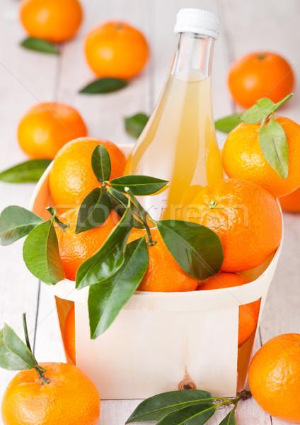 Vidro garrafa fresco mandarim tangerina suco Foto stock © DenisMArt