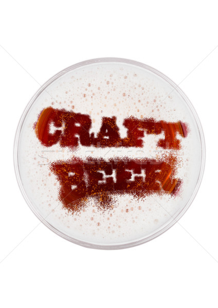 Glass of red ale beer top with craft beer shape Stock photo © DenisMArt
