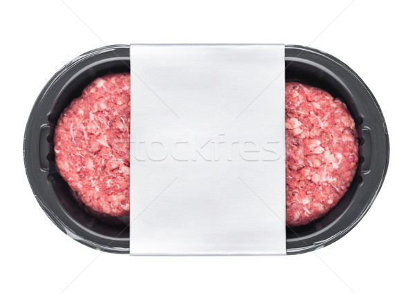Raw fresh beef burgers in plastic tray on white Stock photo © DenisMArt