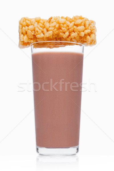 Glass of breakfast chocolate milk with cereal bar Stock photo © DenisMArt