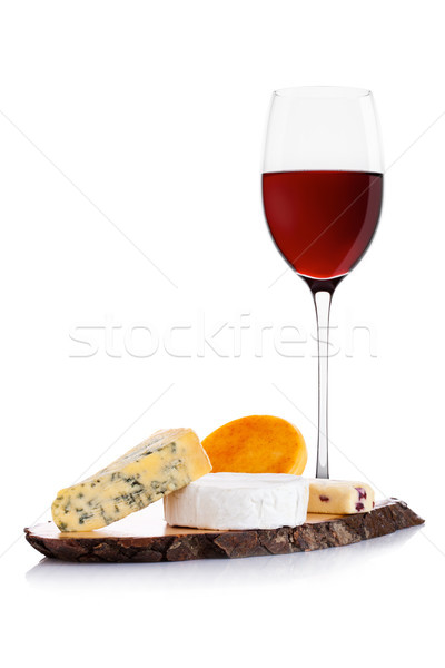Glass of red wine with cheese selection and grapes Stock photo © DenisMArt