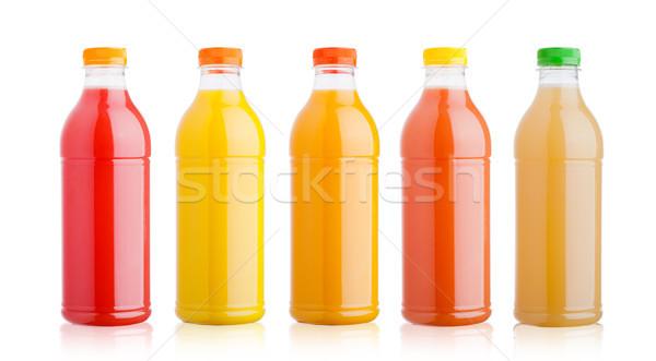 Plastic bottles with fresh organic juice on white Stock photo © DenisMArt