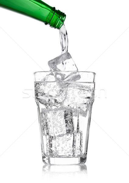 Pouring lemonade soda drink from bottle to glass Stock photo © DenisMArt