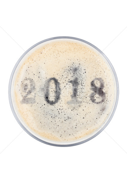 Glass of stout beer top with 2018 year digits Stock photo © DenisMArt