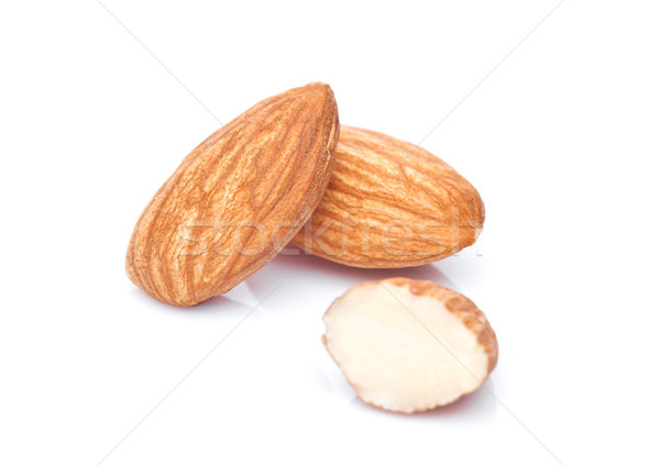 Healthy almonds nuts macro on white  Stock photo © DenisMArt