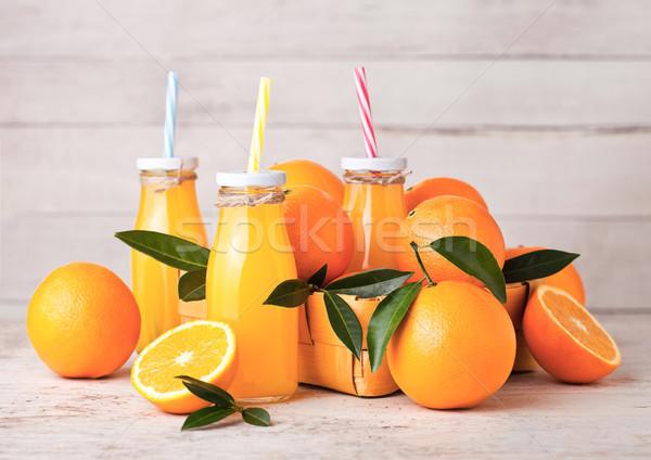 Vidrio botellas crudo orgánico frescos jugo de naranja Foto stock © DenisMArt