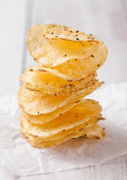 Crujiente delicioso pimienta papa chips Foto stock © DenisMArt