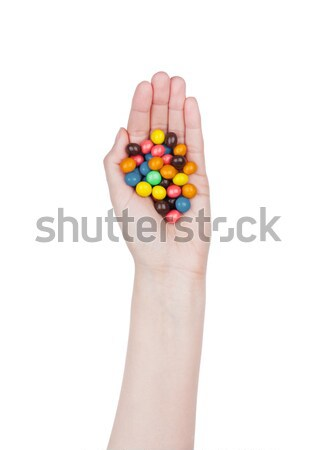 Female hand hold round color chocolate candies  Stock photo © DenisMArt