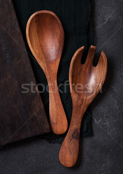 Vintage kitchen wooden utensils over black cloth on stone table background. Top view.  Stock photo © DenisMArt