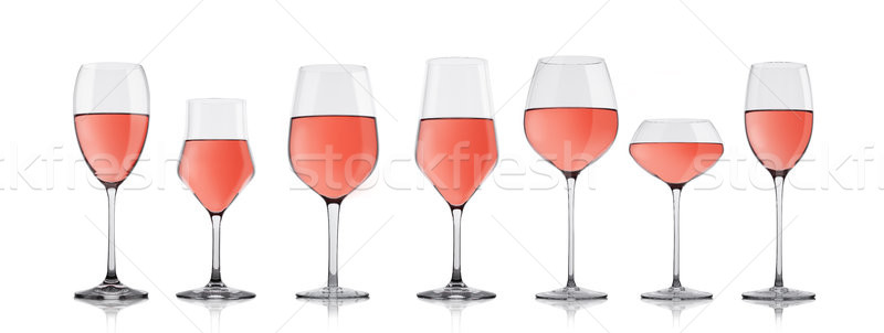 Glasses of rose pink wine on white with reflection Stock photo © DenisMArt