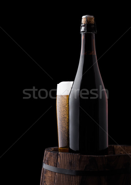 Cold bottle and glass of craft beer on old barrel Stock photo © DenisMArt