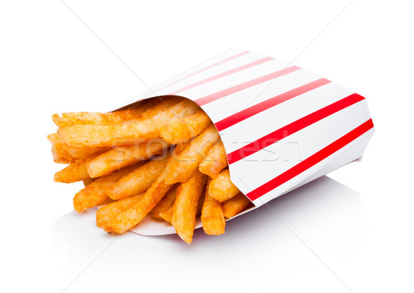 Southern french fries in paper container on white Stock photo © DenisMArt