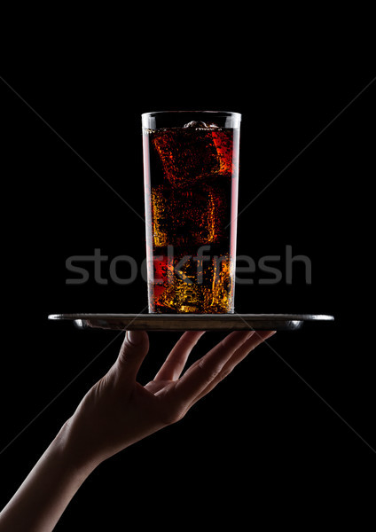 Hand  holds tray with glass of cola soda drink Stock photo © DenisMArt