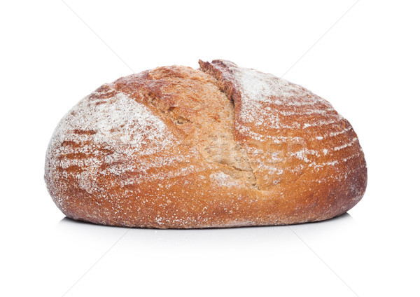 Freshly baked  loaf of bread with flour on white Stock photo © DenisMArt