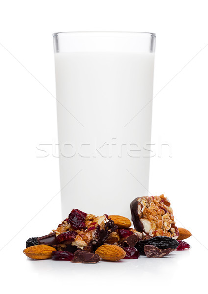 Cereal bar bits almond chocolate and glass of milk Stock photo © DenisMArt
