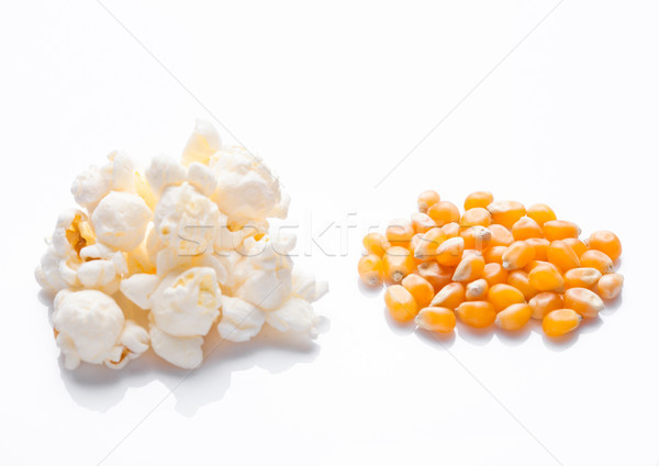 Raw golden sweet corn and popcorn seeds on white Stock photo © DenisMArt