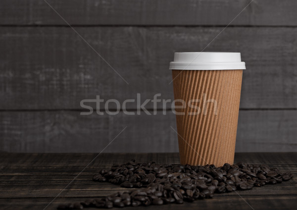 Papier tasse de café cappuccino grains de café bois fond Photo stock © DenisMArt