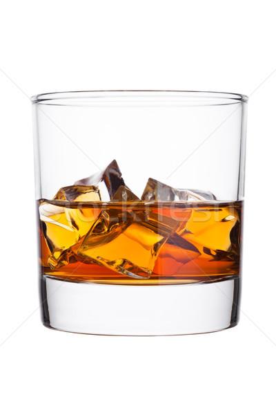Elegant glass of whiskey with ice cubes Stock photo © DenisMArt