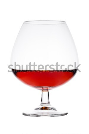 Elegant glass with brandy cognac alcohol drink Stock photo © DenisMArt