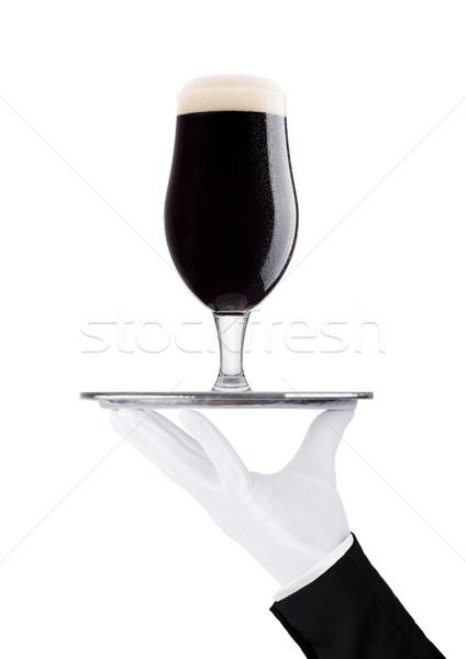 Hand with gloveholds tray with stout dark beer  Stock photo © DenisMArt