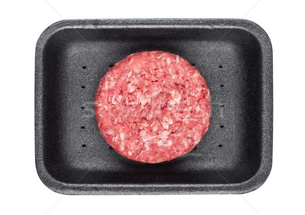 Raw fresh beef burger in plastic tray on white Stock photo © DenisMArt